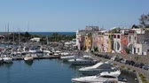 Procida, Marina di Chiaiolella. View of the marina and small fishermens houses overlooking the sea. Real time summer shot.