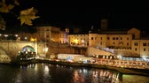 Nightlife in Rome on the River Tiber. Along the Tiber River in Romes summer night life. Time-lapse, in the scene the protagonists are the people who stroll down to the river and attend nightclubs. River water flows through the opposite movement of people