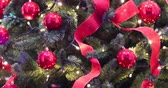 decoração do natal : Christmas lights - vertical, slow motion on lights, ribbons and red balls, Christmas tree. Decorations, ornate Christmas tree.