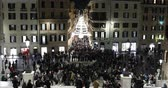 Piazza di Spagna taken from the steps of Trinit? dei Monti. In the foreground the crowded square, with many people in the Christmas time, in the background