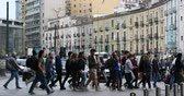 Naples, Italy - April 17, 2019: Garibaldi central station, many people cross the street on the pedestrian crossing in both directions. In the background, the buildings of the traffic lights.
