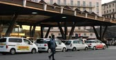 Naples, Italy - April 17, 2019: Piazza Garibaldi, taxi ranks in front of the train station. Taxi lined up in front of the central station. Stok Video