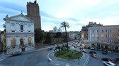 Rome Italy timelapse - Roundabout in the city with cars and pedestrians crossing. Church of St. Catherine of Siena, Torre delle Milizie.