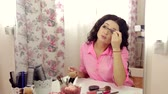 mroczne : Woman makeup make-up applying mascara looking at the mirror