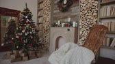 corner : Presents and gifts under christmas tree in the decorated room, new year concept Stock Footage