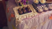 celebration : Beautiful festive table with a variety of delicious desserts stylish decoration