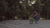 construir : Ryder in the park by BMX makes a jump through steps and scrolls.