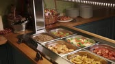 lunchroom : close up shot of the buffet in the hotel, in the containers with Podogev are fried cutlets, steamed vegetables, potatoes, scrambled eggs, fried sausages, buckwheat and sour cream