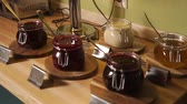 lunchroom : Pots with berry marmalade placed on a table.Camera is panning part of continental breakfast . Stock Footage