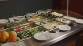 lunchroom : Smorgasbord with vegetables salads. Camera is showing lettuces, olives, kinds of cheese lying in a dishes