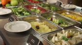 lunchroom : Vegetarian meals on a buffet in a restaurant. Vegetables and herbs is lying in plates, fruits, olives and cut cheese