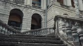 arkeolojik : a beautiful old architectural structure, a stone or marble staircase leads us to the entrance to a mansion that seems abandoned
