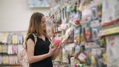 baby store : Portrait of a beautiful blonde mother buying toys for children at home, wide range of toys for kid of all ages. Woman shopping in toy department store.