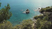 洞窟 : Picturesque landscape of Mediterranean sea in sunny day. View from high rocks on stone coast, small ripple on water surface