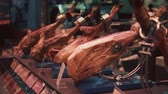 frankfurters : Spanish specialties dry-cured ham is placed on a counter of old food market. Jamon is traditional exquisite delicacy of Spain Stock Footage