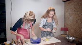 modelling : Two young women are working in pottery, making clay tableware