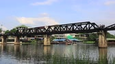 Kwai river bridge, Kanchanaburi, Thailand from below at river bank showing concrete supports