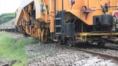 restauração : Bangkok, Thailand - September 5, 2015 : Restoration the railroad tracks by Plasser and Theurer machine at State Railway of Thailand.