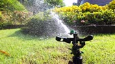 Springer water system used for watering plant and flower in the garden, 4k ultra HD slow motion.