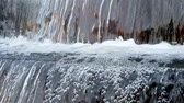 Macro shot of water flow falling down into water making foam in fountain slow motion full HD, 1080p