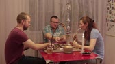 game : Women and men smoking shisha and playing cards Stock Footage
