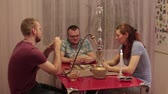 game : People having fun with a hookah and playing cards Stock Footage