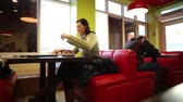 substantial : Woman In Cafe Eating Doner Kebab