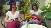 coxa : Women are sitting in a cafe with smartphones Stock Footage