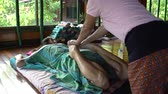 pedicure : Thai masseuse kneads the legs of a woman