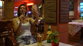 khaosan : A woman makes selfie with a roasted cockroach in a Thai restaurant