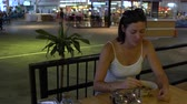 Махараштра : Woman eating Pad Thai at the station cafe