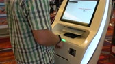 aeronave : Man prints a ticket at the airport terminal