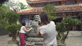 touristic place : Women are photographed near the Buddha statue near the temple