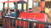 карусель : Amusement park. Women are sitting in a train. Roller coaster
