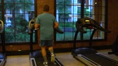 stamina : Man goes in for sports on the treadmill at the gym