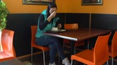 Woman eats in cafe sitting at the table