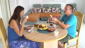 Couple having breakfast at the table at home Wideo