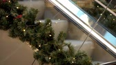 a moving escalator in a big mall during the christmas holidays, with xmas ornaments