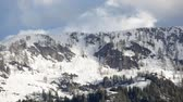 Video of clouds passing over a snow covered mountaintop in Carinthia, Austria. Stock Footage