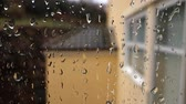 raindrops seen from inside sliding off from a windows of a building Stock Footage