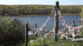 divórcio : Pagan colorful cloth for spirits on the cliff over river