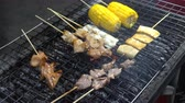 Cook roasts juicy kebab barbecue on the grill on street food of thailand Stok Video