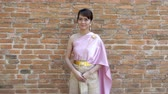 Шива : Thai woman in thai traditional dress in archaeological site Стоковые видеозаписи