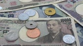 banknot : Close up of Japanese coin yen falling on banknotes 1000 and 10000 yen background with sound