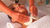 facial : Woman getting facial massage in beauty spa.