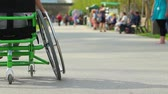 young : Group of people with disabled friends in wheelchair Stock Footage