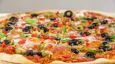 salami slice : Beautiful multi colored and crispy olive pizza Stock Footage
