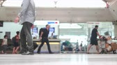 pack : Slightly defocused 4 video pack of crowd of people walking in the airport corridor