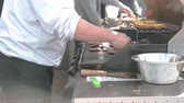 trimmings : A side view of chef checking burger meat Stock Footage