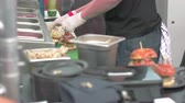 trimmings : A chef putting burger sliders together Stock Footage